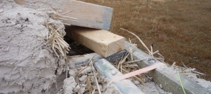 Attaching the roof to the ring beam of a straw bale wall