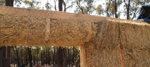 Filling the gap above a window with straw bales