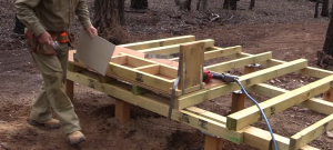 attaching bush fire protective materials to the underfloor of a straw bale house
