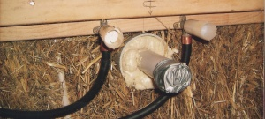 Installation of plumbing through a straw bale wall